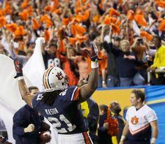 Auburn running back Tre Mason (21) celebrates one of his four rushing touchdowns against Missouri. (Dave Martin/AP)