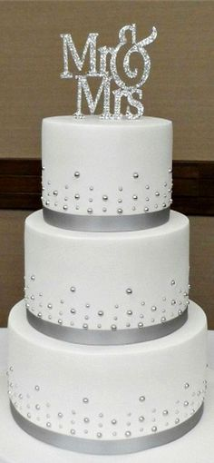Ribbon on Cake is same color I'm thinking. Don't like how thick the layers are though. Gems could be cute if not difficult to place, but not necessary #weddingcakes