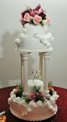 2 Tier Wedding Cake with Columns and Icing Roses
