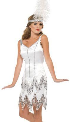 20-luvun flapper -asu päähineellä. Kaunis, flapper-tyylinen mekko ja sulkapäähine muodostavat hienon naamiaisasukokonaisuuden 20-luvun bileisiin.