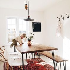 living room design // simple table, bench, eames chairs, vintage rug
