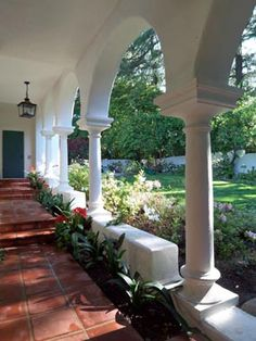 A Spanish Colonial Revival house and porch w/garden in Las Fuentes.
