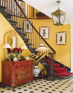 Fabulous foyer, love the red chinoiserie chest and adore red and yellow.