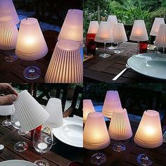 Next time you're having a backyard do, get some vellum (or small lampshades) to cover your extra wine glasses for wind-proof (and better-looking) tealight holders.  Would even look good inside.