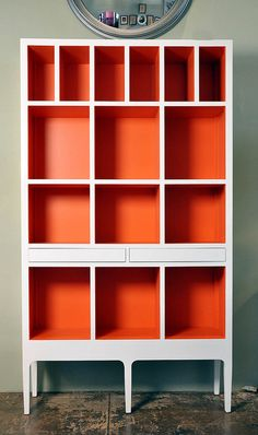 I love the idea of adding really bold colours in hidden spaces, like the interior of cabinets, closets, or washrooms. coloredbookcase.jpg (379×640)