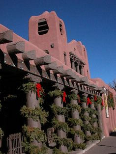 Santa Fe, NM: Christmas adobe. All the downtown is decorated with real evergreen garlands!