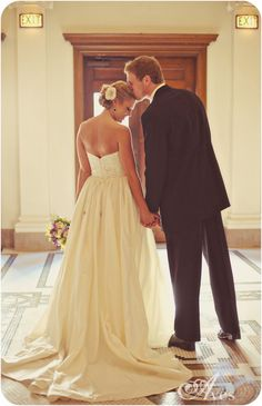 Wedding photo ideas:  This is adorable.  It's another forehead kiss, but full body, from the back... love.