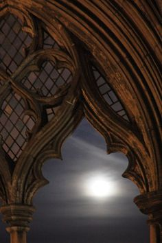 The moon as seen from a cloister in Norwich Cathedral, England