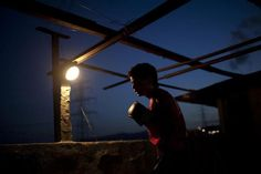 Javier Apolinar, 14, practises Olympics-style street boxing during a training session at a gym in the low-income neighborhood of La Vega in Caracas February 10, 2011.  REUTERS/Carlos Garcia Rawlins