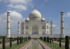 """The Taj Mahal, """"crown of palaces,"""" is a white marble mausoleum located in Agra, India. It was built by Mughal emperor, Shah Jahan, in memory of his third wife, Mumtaz Mahal. The Taj Mahal is widely recognized as """"the jewel"""" of Muslim art in India and one of the universally admired masterpieces of the world's heritage."""""""