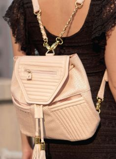 A geometric bag with quilted and perforated leather panels, fully lined satin lining, gold hardware, and geometric heart-shaped mirror!!!. By Mata Har