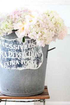 If you slightly smash the ends of your cut hydrangeas and add ice to the water they will last much longer