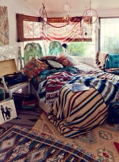 beautiful boho bedroom. Love the overlapping rugs.