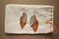 DIY Leather feather earrings.
