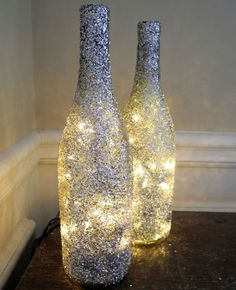 Image 12 of 17 from gallery of Cool DIY Bottle Lamp Ideas To Add Unique Home Decor. This diy wine bottle lamp will add glittery effect to any room Glitter Wine Bottles, Wine Bottle Art, Lighted Wine Bottles, Bottle Lights, Wine Bottle Crafts, Glass Bottles, Glass Lights, Empty Bottles, Altered Bottles