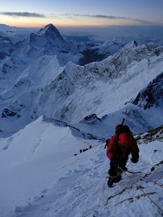 Climbing towards the South Summit of Mt. Everest at sunrise.
