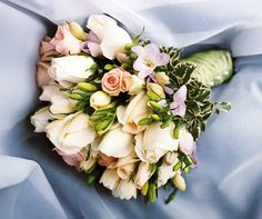 Sweet garden bouquet of blush roses, sweet pea, and freesia.