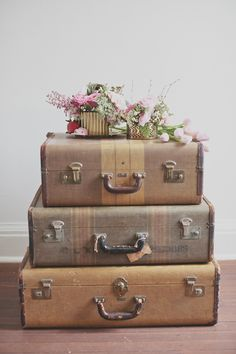 Love suitcases as decor, theme could be echoed at the wedding reception