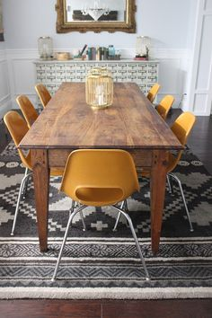 Dining Room Table And Chairs by Dream Book Design...I would go for different color chairs