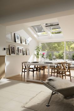 Gorgeous bright dining room with roof windows. Dining room dreams. This is my dream dining room with lots of natural light and plenty of space for parties. Scandinavian style dining room with wishbone chairs in oak.