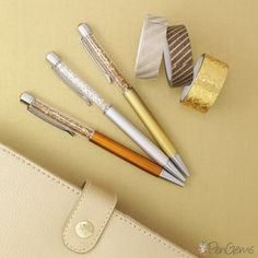 Gold, Silver, and Bronze crystal pens.