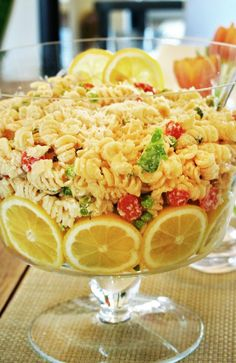 A pasta salad with the bowl lined with slices of lemon to add color, oranges or limes would be beautiful too.  This would work for any salad presentation