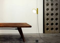 A weighted, hanging LED light. Pretty cool. OK lamp revoking Castiglionis Parentesi by Konstantin Grcic for Flos