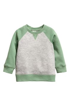 Long-sleeved sweatshirt in soft, organic cotton fabric. Snap fastener on one shoulder (sizes 1 - without snap fastener) and ribbing at neckline, cuffs, a Little Boy Outfits, Toddler Outfits, Baby Boy Outfits, Kids Outfits, Girls Clothes Shops, Coton Bio, Baby Kids Clothes, Baby Boy Fashion, Grey Sweatshirt