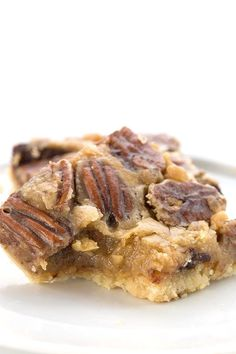 Gooey keto pecan pie bar with a bite taken out of it