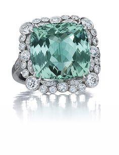 cushion-cut Paraiba tourmaline ring surrounded by diamonds
