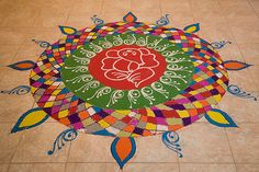 Rangoli is a folk art from India. These are decorative designs made on floors of living rooms and courtyards during Hindu festivals and are meant as sacred welcoming areas for the Hindu deities.