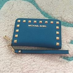 NEVER USED- MK Aqua Smartphone Wristlet Never used MK Smartphone Wristlet, Aqua with gold studded detail. Perfect for summer! Michael Kors Bags Clutches & Wristlets
