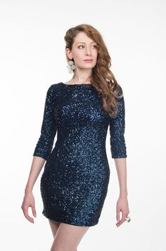 """Channe a bit of """"Skyfall"""" glamour in the Navy Sequin Alice Dress.  Enter the code """"BANDJAM"""" at check out to donate 10% of your purchase to the Make-A-Wish Foundation and Saint Louise House till December 12th."""