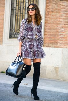 Alexandra Pereira wears thigh high boots with a cute bohemian style floral dress and shades, creating a simple but sophisticated spring look! We love it! Dress: Buylevard, Coat: Zara, Boots: Asos, Bag: Givenchy.