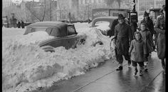 Cars are covered with snow in 57th St., Central Park South - New York, following the city's first snowfall of 1938. (Horace Abrahams/Fox Photos/Getty Images)