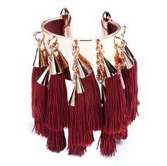 Victoria's Secret Fashion Show jewelry from Eddie Borgo: Silk tassel cuff with rose gold.