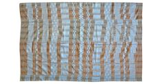 A very fine and rare Yoruba women's wrapper cloth with ice blue raw silk embroidery on a handspun natural cotton base with woven loose patterned strings. Circa 1950s.