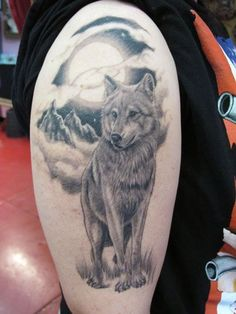 Wolf tattoo by Adrian Gallegos... the background idea is cool but that wolf doesn't look intimidating enough.