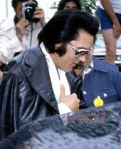 Elvis getting into Limo with the assistance of friend/road manager, Joe Esposito