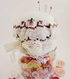 A doily pincushion jar