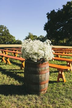 babys breath would be a perfect way to get that wow on our wine barrels / http://www.deerpearlflowers.com/35-creative-rustic-wedding-ideas-to-use-wine-barrels/2/