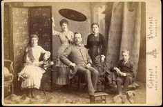 BEAUTIFUL CABINET CARD OF A WEALTHY FAMILY POSED WITH THEIR DOG.