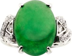 Jadeite Jade, Diamond, White Gold Ring The ring features an oval-shaped jadeite jade cabochon measuring 16.54 x 12.00 x 3.75 mm and weighing approximately 6.00 carats, enhanced by full-cut diamonds weighing a total of approximately 0.25 carat, set in 14k white gold. A GIA Laboratory report # 6137101399, dated February 22, 2011, stating Natural Color, No indications of impregnation, accompanies the jade.