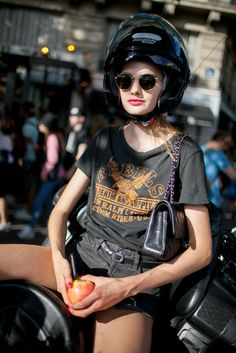An apple a day.... Spotted on the streets of Paris during Couture Week. [Photo: Kuba Dabrowski]