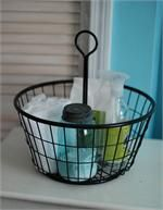 """This Black Wire Egg Basket is the perfect addition to your farmhouse style decor. There are so many uses for this country classic. Collect eggs from the chicken coop, keep yarn tucked away or use it as a cleaning caddy. Features a vintage design and center handle for easy access to your stored items. Made of sturdy iron, this wire basket will be a durable assistant for generations to come. 14.5""""H x 14""""Diam"""