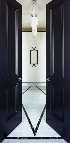 Elegant black french inspired front entrance doors. Favorite doors of www.andrearodman.com A Vancouver based Interior Design Firm.