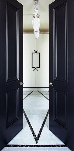 Elegant black french inspired front entrance doors. Favorite doors of www.andrearodman.com A Vancouver based Interior Design Firm.