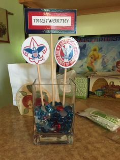 Centerpieces for an Eagle Scout Court of Honor Reception. We made one for each of the 12 points of the Scout Law.