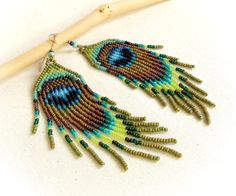 Hey, I found this really awesome Etsy listing at https://www.etsy.com/listing/278722960/long-earrings-seed-beads-fringes-peacock