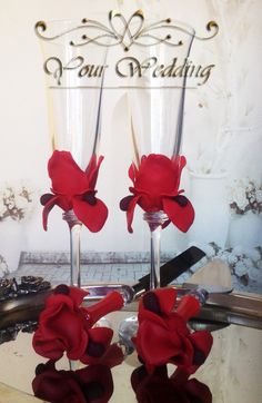 Wedding champagne flutes Red Iris flower Cake serving set server knife Details  Delicate set of 2 hand decorated champagne flutes with red iris flower and a cake serving set with the same design. Author's design.  Color: Red and burgundy red Names and the wedding date can be painted on the base of the glass in pearly white color for no charge, just send me a message. Gentle hand wash only, don't soak in water. Height 24cm, volume 200ml.  Visit YourWedding.artfire.com